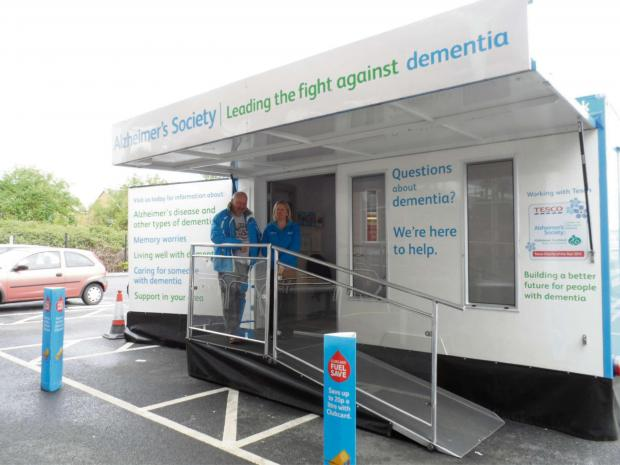 John Church and Caroline Smith from the Alzheimer's Society on board the Dementia community roadshow vehicle.