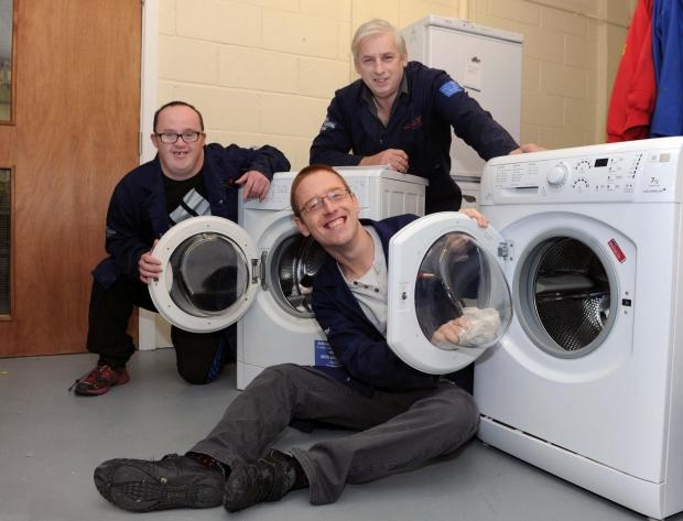 WHITE ON TIME: Fixing washing machines are Jason Jenkins, Andrew Davies and Coastal  White goods tech Stuart Brain.