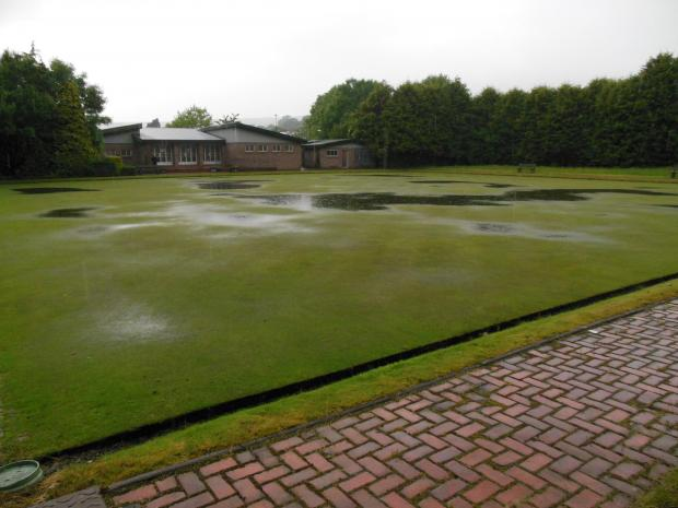 RAIN STOPPED PLAY: The soggy scene at Cwmaman Bowling Club on Monday morning.