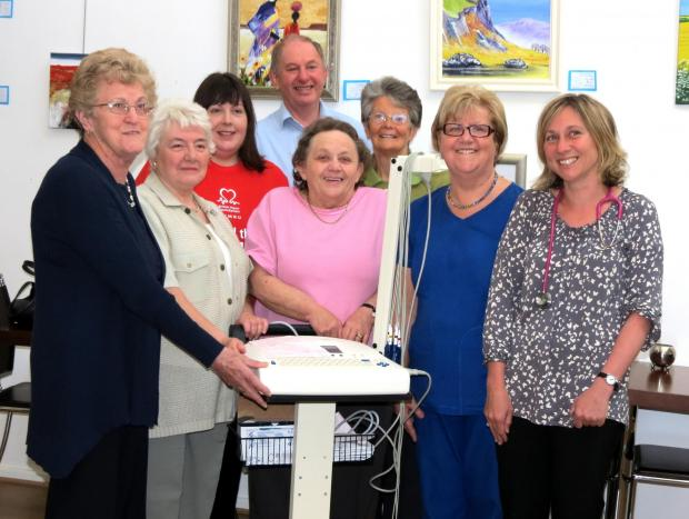DELIGHT: Fundraisers raised £3,000 for an ECG machine at Brynaman surgery, much to the delight of practice doctors and nurses. Pictured left to right are, Mair Hitchings,  Buddug Williams,  Jayne Lewis (BHF Manager)  Mel Morgans,  Anita Humphreys, W