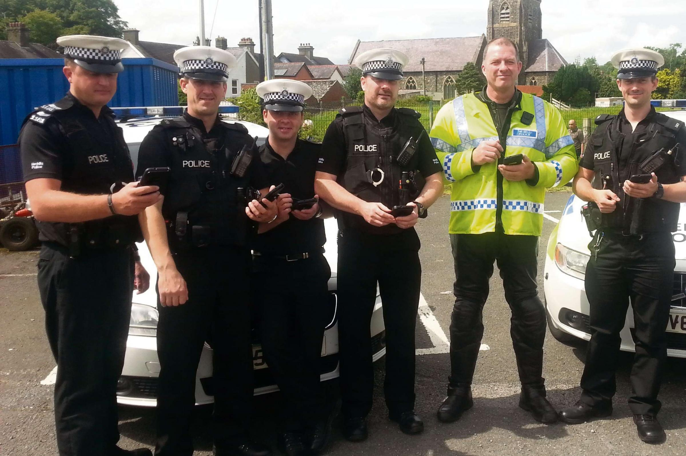 HI-TECH POLICING: Carmarthenshire officers are being issued with handheld tablet devices.