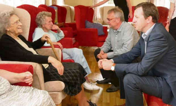 DIGNITY: MP Jonathan Edwards and Rhodri Glyn Thomas AM chat with residents at Llys Newydd, Capel Hendre, as part of a National Care Home Open Day visit.