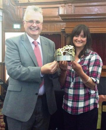 TOP STUFF: Carmarthenshire council lead Kevin Madge and Garnant artist Angharad Pearce Jones with the Eisteddfod Crown.