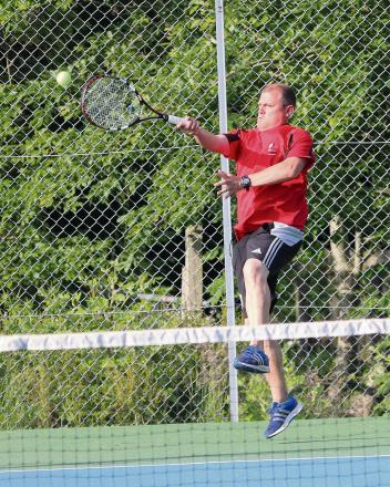 SKIPPER'S SWIPE: Llandybie Seconds captain Jonathan Thomas looks to power out from the back of the court against Aberaeron. The seconds lost 4-2.Pic: SDD