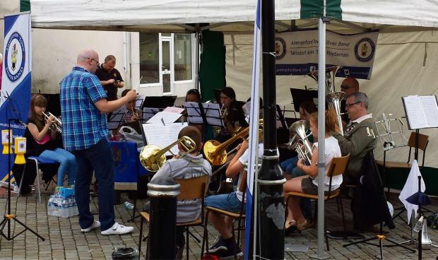 The junior section of Ammanford town silver band entertain shoppers as part of the band's playathon.