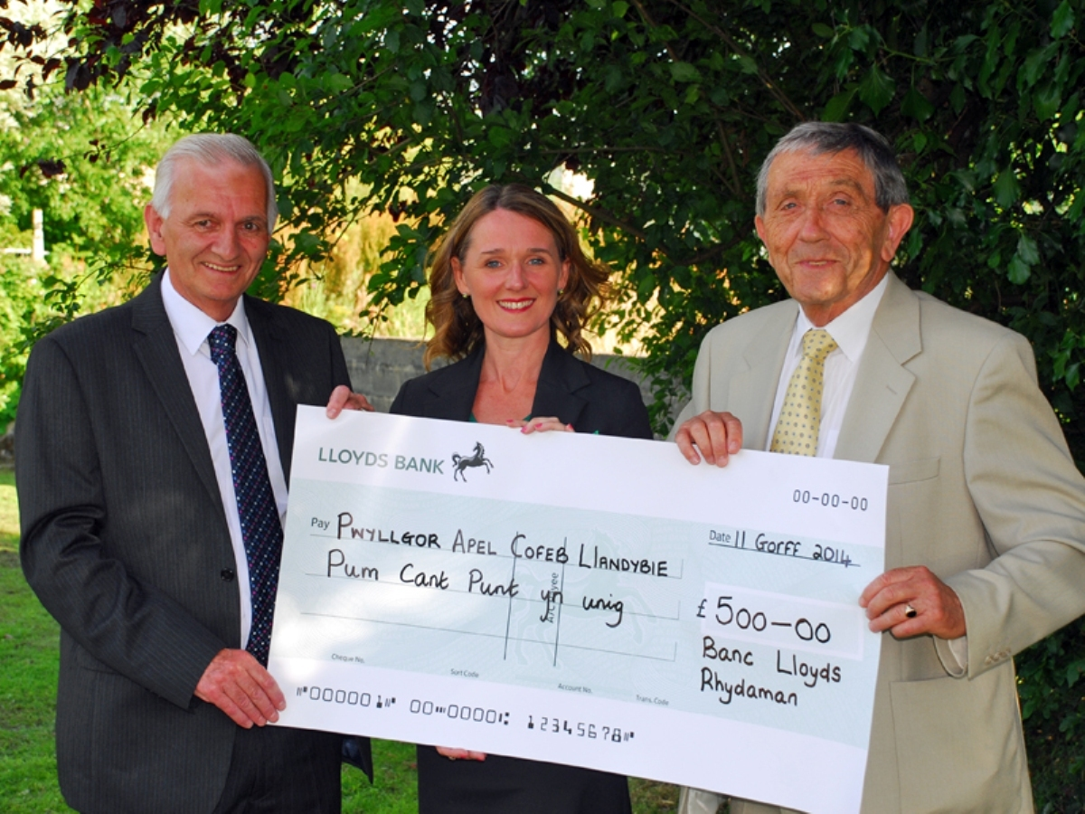 CHEQUE MATES: Lloyds Bank's Emma Evans presents a cheque for £500 to Llandybie Eisteddfod Commemoration Committee treasurer Tom L Jones (left) and chairman Alun M Lloyd. Picture: Arwel Davies, Carmarthen.