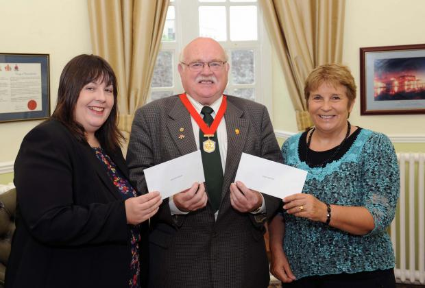 CHEQUE MATES: Carmarthenshire County Council Chair Councillor Terry Davies presents cheques for £7,000 each to Jayne Lewis of the British Heart Foundation and Cllr Gwyneth Thomas of the Teenage Cancer Trust.