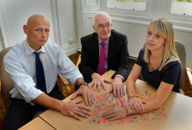 BAND S ON THE RUN: Trading Standards manager Roger Edmunds, Councillor Jim Jones and Lisa Williams customer service officer with a selection of loom bands.
