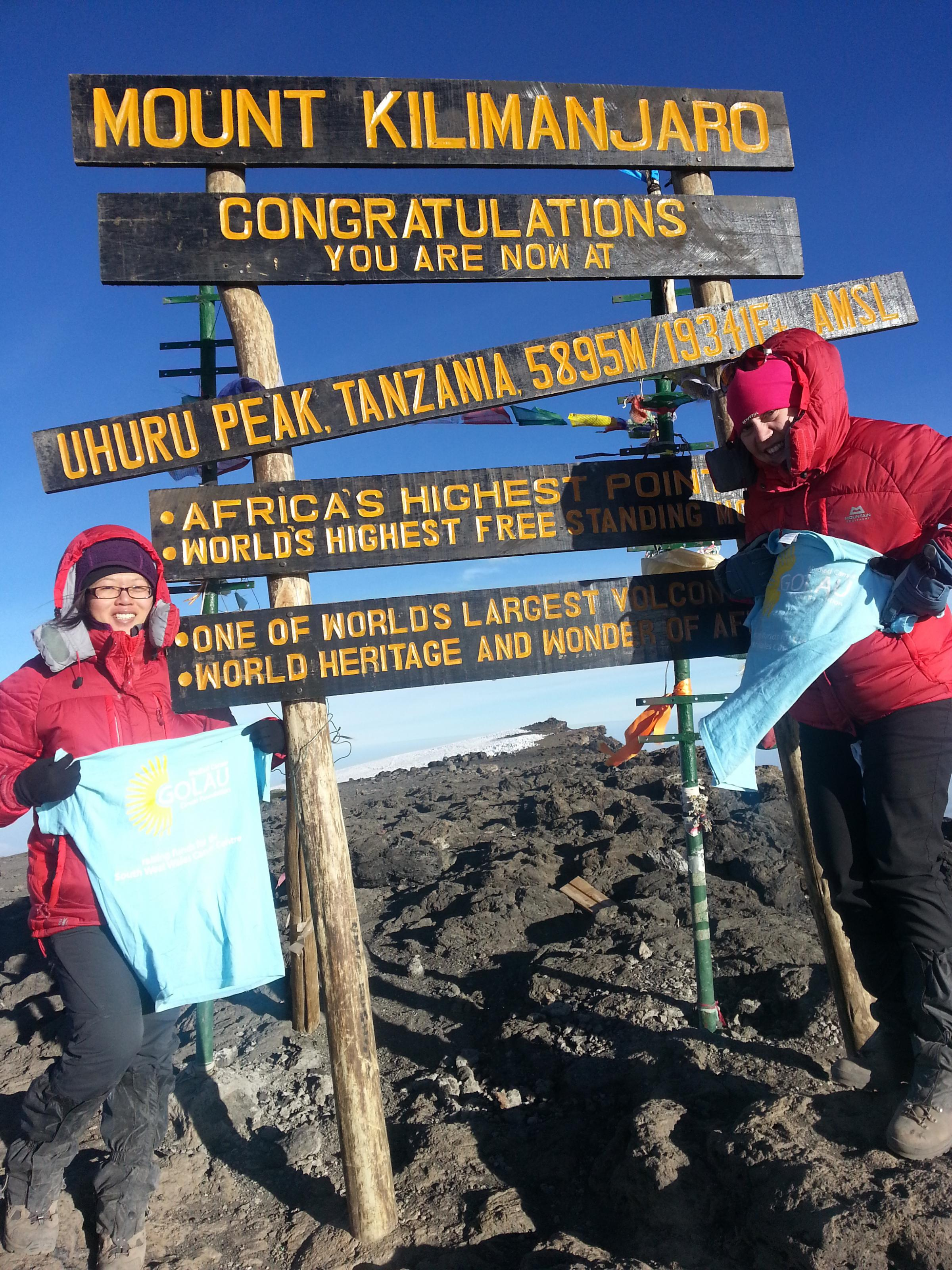 REACHING THE SUMMIT: Following 18 months of training and fundraising Lisa Chan and Harriet Webb have conquered Mount Kilimanjaro for Golau Cancer Foundation.