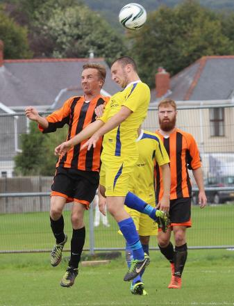 EXTRA TIME CUP THRILLER: Ammanford AFC's Rhys Fisher goes aerial against Trostre. Ammanford won this all action Welsh Cup preliminary round game 3-2.Pic: SDD