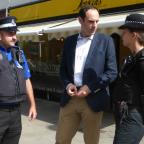 South Wales Guardian: ON THE BEAT: Christopher Salmon, Police and Crime Commissioner for Dyfed-Powys, on his Your Voice Day in Ammanford with PC Sarah Yelland-Davies and PCSO Arwyn Rees.