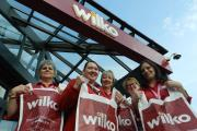 A BAGFUL OF CHARITY: Ammanford's Wilko staff Anne Hyde, Sara Morgan, Sue Jones, Val Doherty and Lisa Greig celebrate the store's latest carrier bag donations.