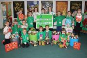 GIFT: Youngsters from Ysgol Gymraeg Rhydaman donated more than 130kg of food and £500 to the Ammanford Foodbank.