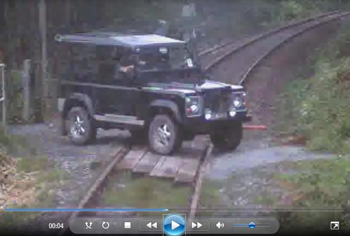 A Ffairfach driver had a narrow escape after his Landrover was struck by a passing train.
