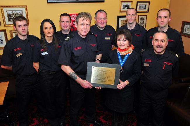 Elinor Jones, High Sheriff of Dyfed, presents Ozy Jones and his crew with the plaque Picture by Mark Davies