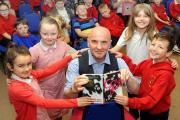 Carmarthenshire schoolchildren taste for books with author Giancarlo Gemin