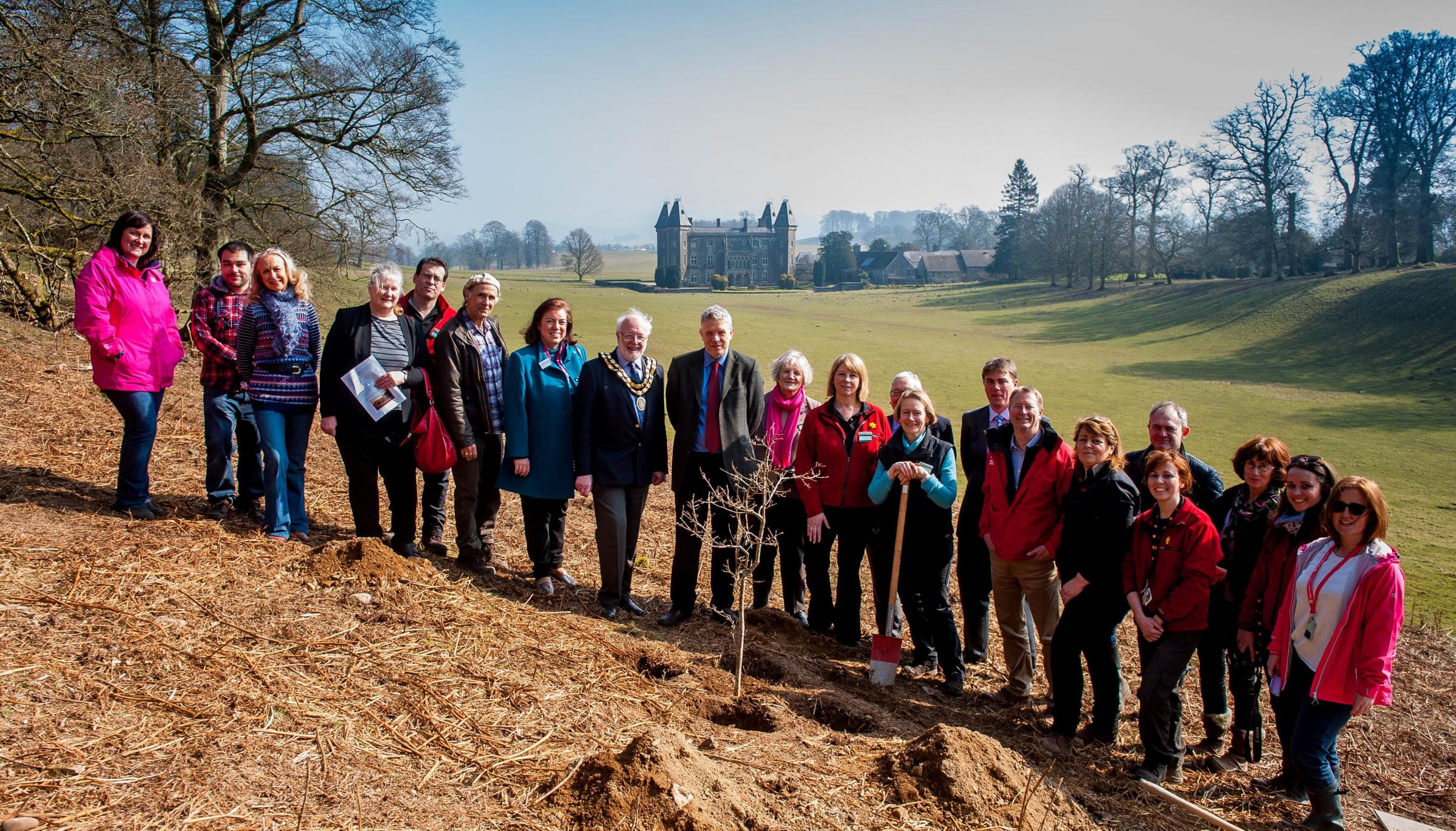 Dame Helen Ghosh plants the tree at Dinefwr Park, Llandeilo looked on by local dignitaries and invited guests. Photo: National Trust/Aled Llewellyn, Athena Picture agency.