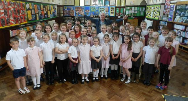 Peter Karrie with the pupils of Ysgol Rhys Prichard, Llandovery.