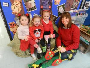 South Wales Guardian: Ysgol Saron pupils Kiki Johnson, Tilly Roberts-Foster, Gracie Murray with Teaching Assistant Mrs Jones. The school took part in a fundraising and awareness day for Red Nose Day and World Down Syndrome Day.
