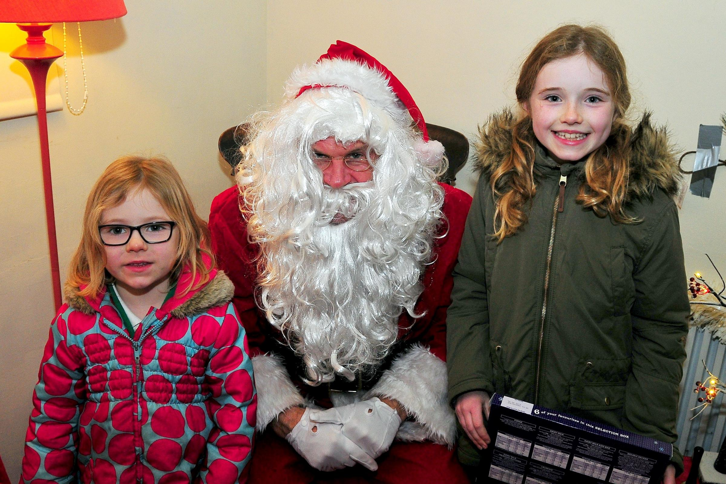 Sisters Nansi (5) and Lili Rees (9) told Santa Claus what they'd like for Christmas during last year's event