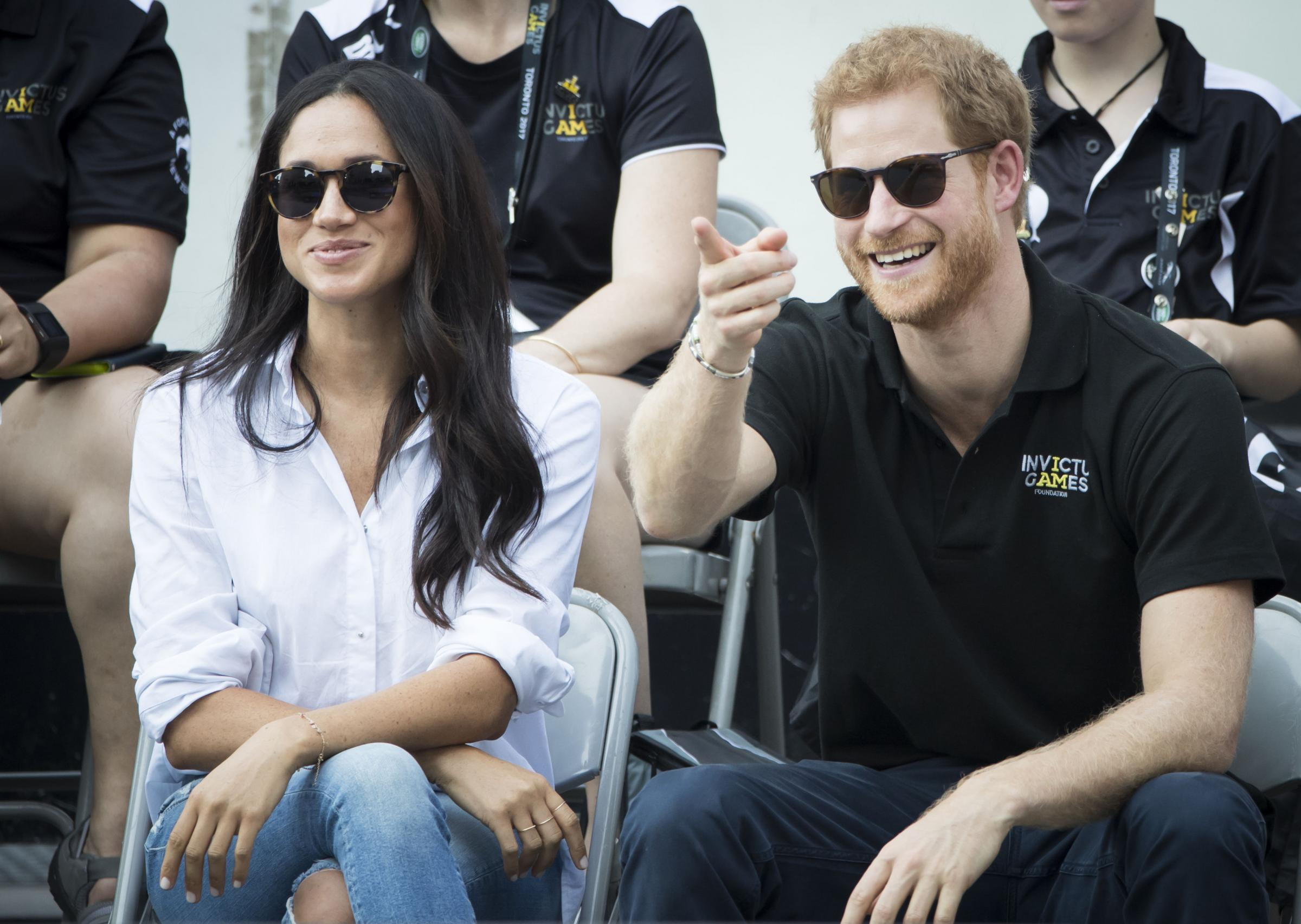 Prince Harry and Meghan Markle watching Wheelchair Tennis at the 2017 Invictus Games in Toronto, Canada, as they have announced their engagement. Pic:Danny Lawson/PA Wire