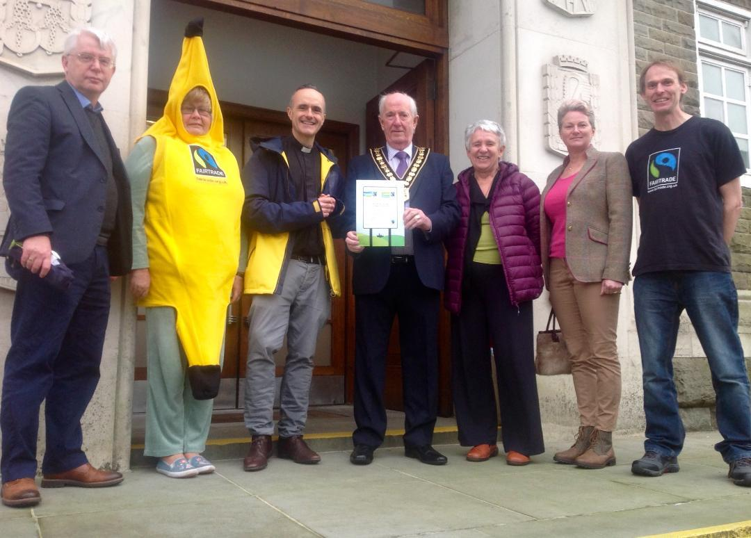 Fair Trade campaigners celebrating Carmarthenshire's Fair Trade County status outside County Hall