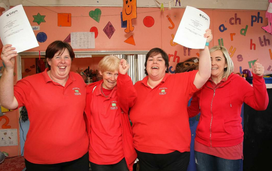Staff at Cylch Meithrin Cefneithin Gorslas celebrating following their excellent Estyn inspection report.