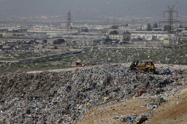 Mountains of rubbish at Spain's largest landfill at Ano Liossia on the outskirts of Athens (Thanassis Stavrakis/AP)