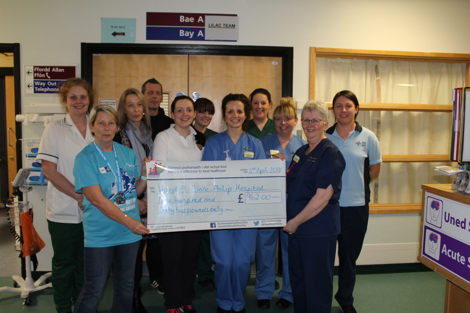 Pictured are Gaynor Davies, Karen Flint and Andrew Flint presenting a cheque to Sister Ann Robins and the team at ward 9.