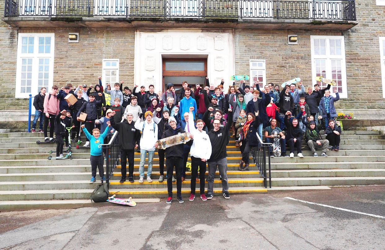 Campaigners on the steps of county hall as they push for a new skate park in Tumble