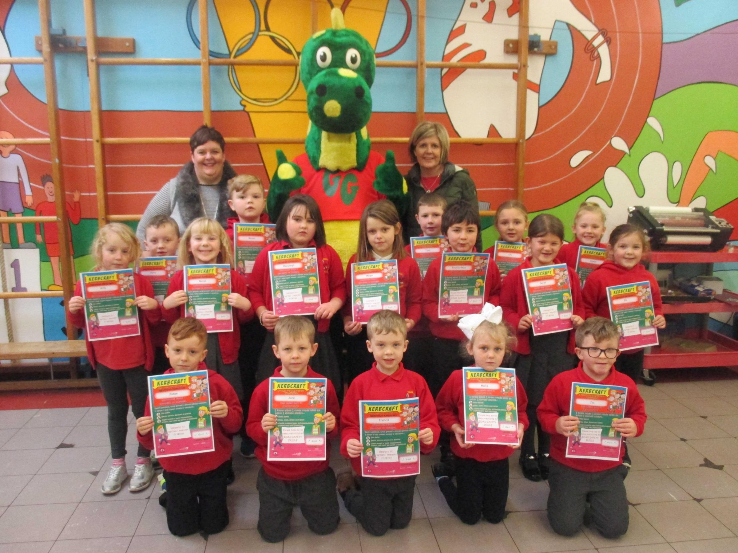 Pupils at Ysgol Llechydedach presented with certificates by Gary GoSafe, accompanied by Carmarthenshire County Council's Kerbcraft staff and trainers.