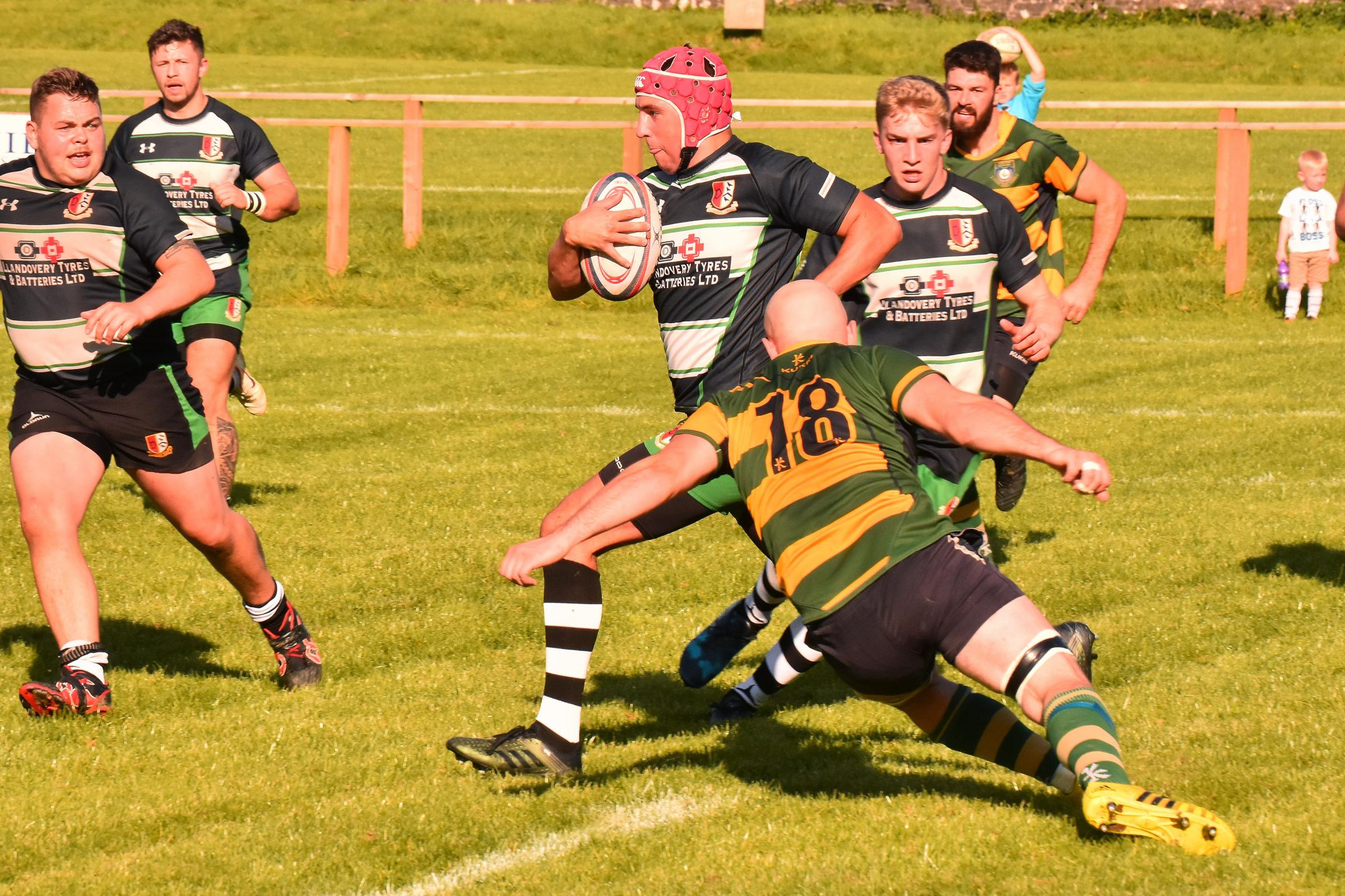 Llandeilo's Rhys Moses-Loynton breaks down field but a last minute drop goal secured a 21 - 19 victory for visiting Cefneithin.  Pic Mark Davies