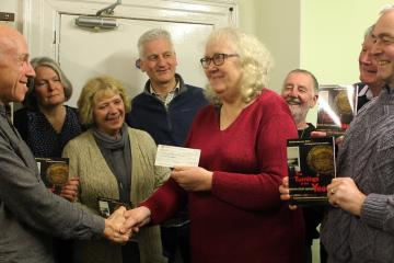 Writers group donate cheque to centre