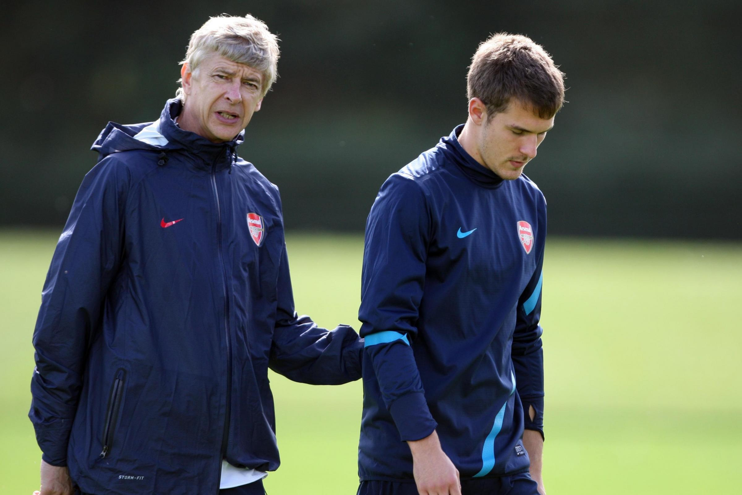 Arsene Wenger, left, believes the departure of Ramsey will be a big setback for Arsenal