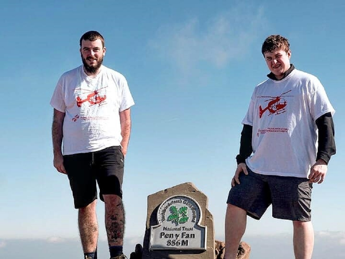 Ray Thompson and Matthew Peters climbed Pen y Fan five times on Saturday in aid of Wales Air Ambulance