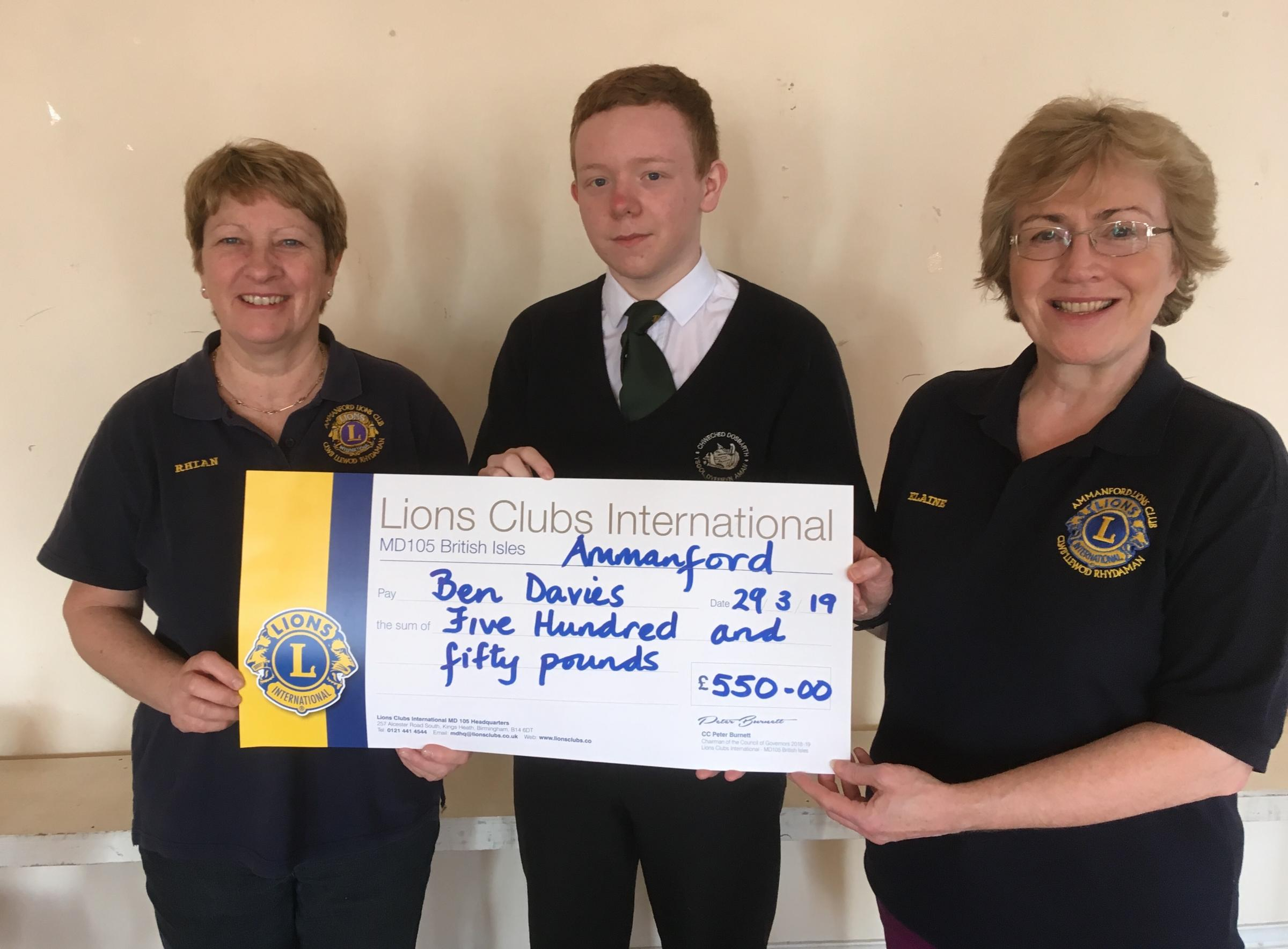 Lions Elaine and Rhian present Ben Davies with a cheque of £550
