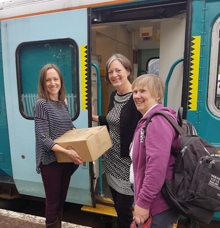 Kate Powlesland, Lisa Denison and Cathy Pearce at Llandrindod Wells Station with the skincare delivery